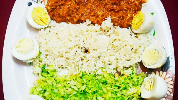 Tri color( egg khurchan with white rice and palak rice)